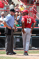 Harrisburg Senators Tony Beasley #13 argues a call with umpire Joseph Born during a game against the Erie SeaWolves at Jerry Uht Park on August 7, 2011 in Erie, Pennsylvania.  Harrisburg defeated Erie 6-1.  (Mike Janes/Four Seam Images)