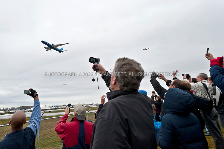 12/15/2009--Everett, WA, USA....A popular destination near Seattle is the Boeing factory and airport just north f od Seattle where visitors can watch the new 787 Dreamliner, seen here, test fly...The Boeing 787 Dreamliner is a mid-sized, wide body, twin engined jet airliner currently under development by Boeing .It will carry between 210 and 330 passengers depending on the seating configuration. Boeing has stated that it will be more fuel-efficient than comparable earlier Boeing airliners. It will also be the first major airliner to use composite material for most of its construction. Boeing claims that the 787 will be up to 20% more fuel-efficient than current comparable aircraft. ..50% of the aircraft's weight are from the composite materials shown here. Composite materials are significantly lighter and stronger than traditional aircraft materials, making the 787 a very light aircraft for its capabilities. By volume, the 787 will be 80% composite. This will allow the potential to take off from, and land on, relatively short airstrips as the 767 can, yet still have the capability to fly long-haul distances...©2009 Stuart Isett. All rights reserved