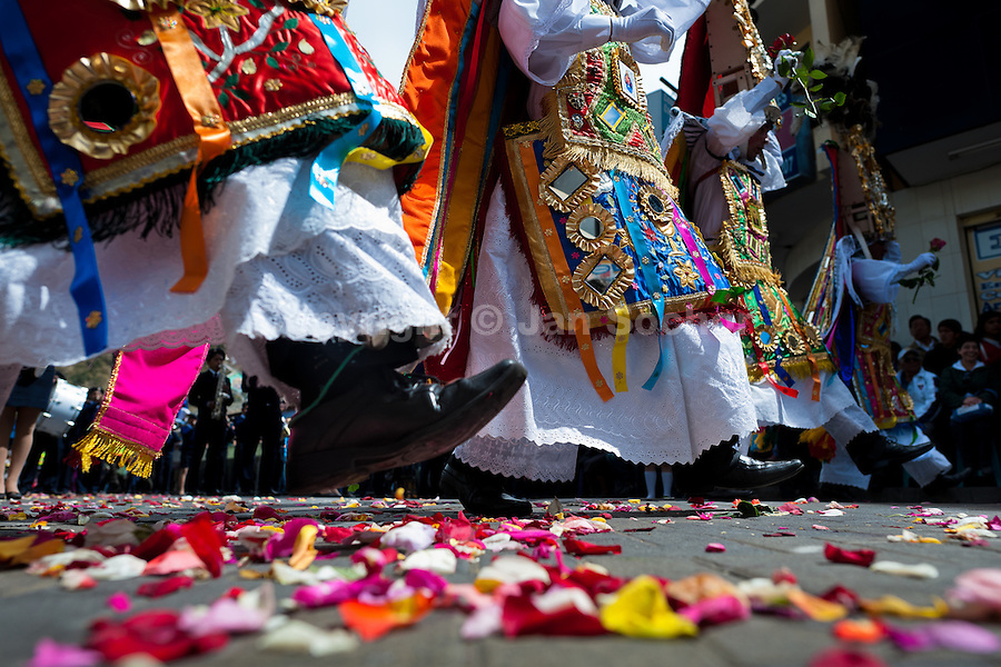 Dancers (danzantes) perform in the religious parade within the Corpus Christi festival in Pujilí, Ecuador, 10 June 2012. Every year in June, thousands of people gather in a small town of Pujili, high in the Andes, to celebrate the Catholic feast of Corpus Christi. Introduced originally during the Spanish conquest of South America, this celebration merges Catholic rituals of Holy Communion with the traditional Andean harvest and sun festivities (Inti, the Inca sun god). Women dancers perform wearing brightly colored costumes while men dancers wear chest ornaments and heavy elaborate headdresses adorned with mirrors, jewelry, or natural items (shells). Being a dancer in the Corpus Christi ceremonial parade (El Danzante) is considered an honour and a privilege by the indigenous people in Ecuador.