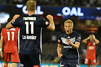 Melbourne, December 8, 2018 - Keisuke Honda of Melbourne Victory celebrates a goal with OLA TOIVONEN (11) in the round seven match of the A-League between Melbourne Victory and Adelaide United at Marvel Stadium, Melbourne, Australia.