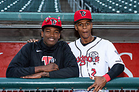 Lansing Lugnuts pitcher Juan De Paula (29) and infielder Otto Lopez (2) pose for a photo before a Midwest League game against the Wisconsin Timber Rattlers at Cooley Law School Stadium on May 2, 2019 in Lansing, Michigan. (Zachary Lucy/Four Seam Images)