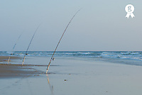 France, Le Porge beach, three fishing rods on beach, outdoors (Licence this image exclusively with Getty: http://www.gettyimages.com/detail/200472237-001 )