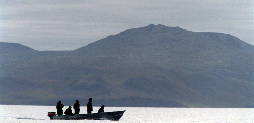 039078.AA.0820.warming2.kc--Bering Sea, Off Providenya, Russia--Hunters stand watch looking for whales. The story deals with the enviromental issue of global warming throughout the region of Russia directly across the Bering Sea from Nome, Alaska. The story touches on the people their way of living, the rough economy and the extent they are effected by the slowly warming temperature as documented by scientists.  More Details To Come.