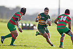 Peni Buakula draws two Waiuku defenders, Sosefo Kata & Sio Petelo, on a midfield run. Counties Manukau Premier Club Rugby game between Waiuku and Pukekohe, played at Waiuku on Saturday May 28th 2011. Pukekohe won 28 - 14 after leading 18 - 14 at halftime.