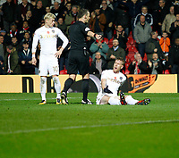 Referee, Stuart Attwell points to the spot much to Pontus Jansson of Leeds United despair during the Sky Bet Championship match between Brentford and Leeds United at Griffin Park, London, England on 4 November 2017. Photo by Carlton Myrie.