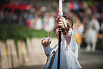 A Buddhist monk shoots ceremonial arrows during the Fire-walking Festival (Hiwatari-sai) at Mt. Takao on Sunday, March 12, 2017 in Hachioji, Japan.<br /> Photo by Kevin Clifford