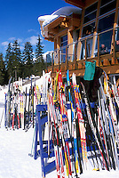 Skis leaning against Ski Racks at the Nordic Center / Centre Day Lodge at Whistler Olympic Park - Site of Vancouver 2010 Winter Games, Whistler Resort, British Columbia, Canada