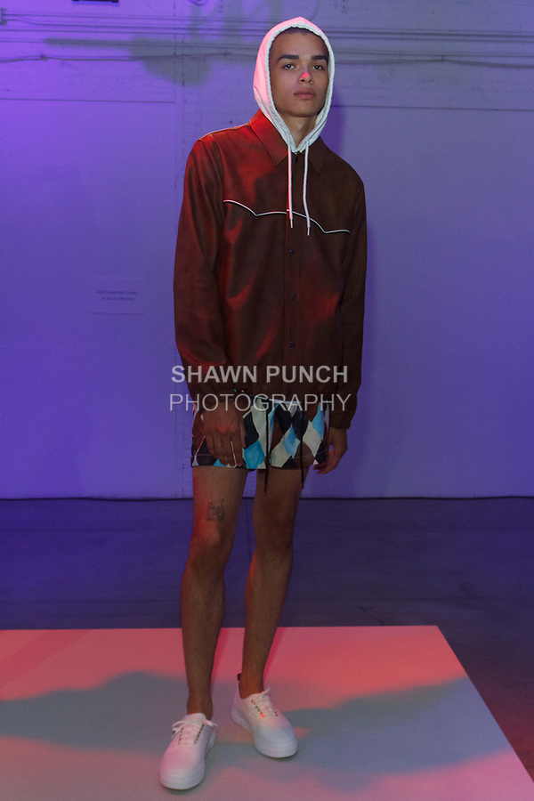 Model poses in an outfit from the You As Spring Summer 2018 collection, at Skylight Clarkson Square on July 13, 2017; during New York Fashion Week: Men's Spring Summer 2018.