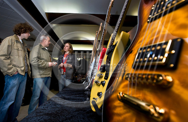 BRUSSELS - BELGIUM - 26 OCTOBER 2008 -- Brosella Guitar Fair in Heysel Expo. -- Guitar producer Juha Ruokangas (Ri) (Ruokangas Guitars) with interested clientele. -- PHOTO: JUHA ROININEN / EUP-IMAGES