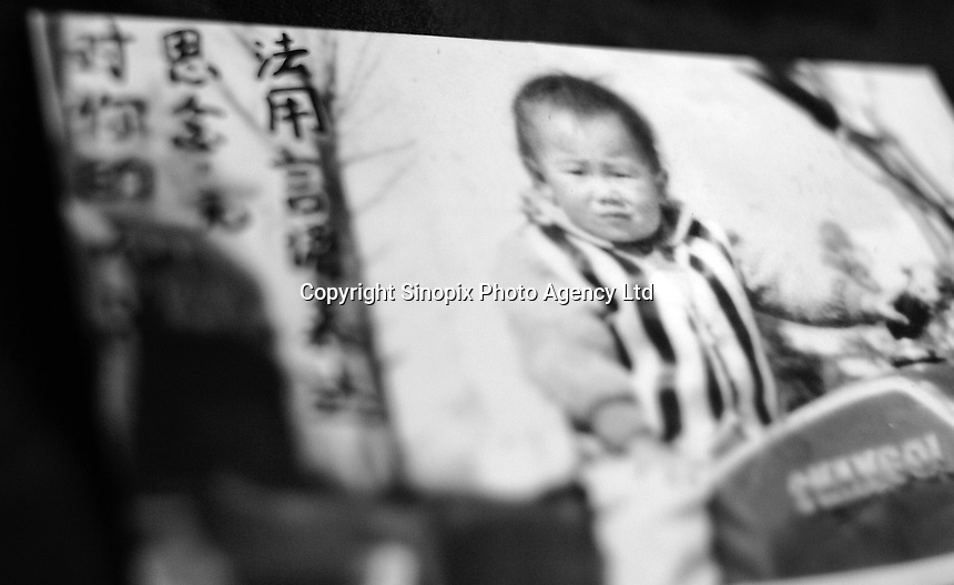 "Picture of a little girl, Lin Yun, 3 years old, lost in GuanDu district in Kumming city on 11 June 2004. Message read ""Our endless missing of you is beyond words.""..PHOTO BY SINOPIX"