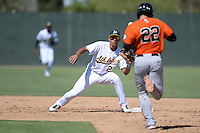 Oakland Athletics infielder Edwin Diaz (29) takes the throw as Christian Arroyo (22) heads to second during an instructional league game against the San Francisco Giants on September 27, 2013 at Papago Park Baseball Complex in Phoenix, Arizona.  (Mike Janes/Four Seam Images)