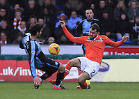 Alex Lawless of Luton Town challenges for the ball during the Sky Bet League 2 match between Wycombe Wanderers and Luton Town at Adams Park, High Wycombe, England on 6 February 2016. Photo by Liam Smith.