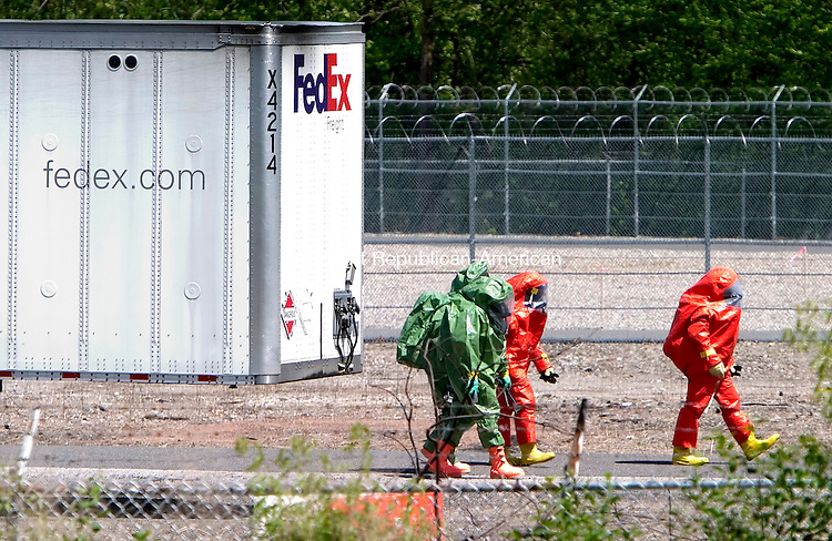 WATERBURY, CT. 06 May 2010-050610SV01--Waterbury firefighters from the Haz-Mat team made entry into a FedEX tractor trailer that was leaking it cargo on South Leonard Street in Waterbury Thursday. The truck was carrying 12-55 gallon drums with Hydrogen Peroxide 24%, Nitric Acid 15%, and Acetic Acid 23%.  Steven Valenti Republican-American