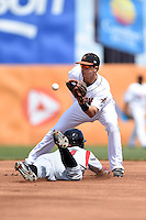 Frederick Keys shortstop Adrian Marin (3) takes a throw as outfielder Luigi Rodriguez (44) slides in during a game against the Carolina Mudcats on April 26, 2014 at Harry Grove Stadium in Frederick, Maryland.  Carolina defeated Frederick 4-2.  (Mike Janes/Four Seam Images)