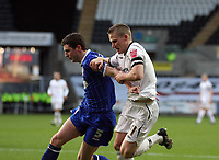 Pictured: Mark Gower of Swansea (R) challenges Alex Bruce of Ipswich Town (L)<br /> Re: Coca Cola Championship, Swansea City FC v Ipswich Town at the Liberty Stadium. Swansea, south Wales, Saturday 07 February 2009<br /> Picture by D Legakis Photography / Athena Picture Agency, Swansea 07815441513