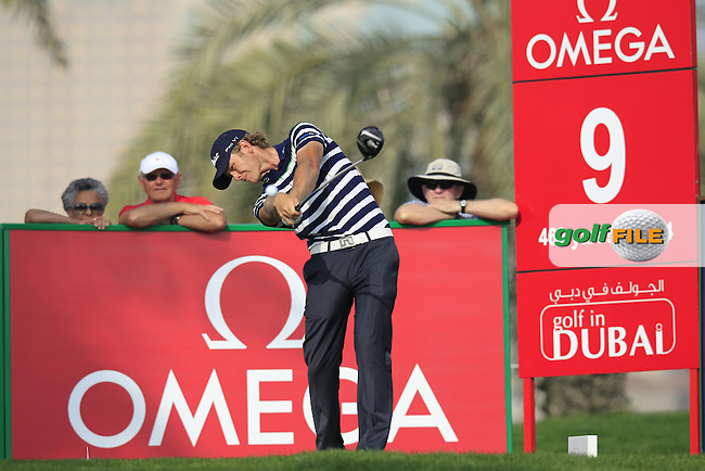 JB Hansen (DEN) tees off the 9th tee during Friday's Round 2 of the Omega Dubai Desert Classic 2014 held at the Emirates Golf Club, Dubai. 31st January 2014.<br /> Picture: Eoin Clarke www.golffile.ie