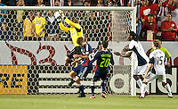 CARSON, CA – APRIL 30, 2011: Chivas USA goalie Dan Kennedy (1) goes up to block a shot on goal during the match between Chivas USA and New England Revolution at the Home Depot Center, April 30, 2011 in Carson, California. Final score Chivas USA 3, New England Revolution 0.
