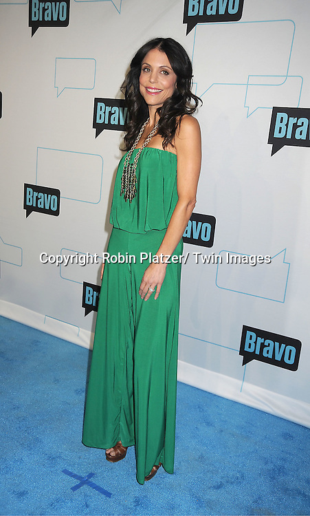 Bethenny Frankel in Sebastian green outfit attends the Bravo Upfront on April 4, 2012 at 548 West 22nd Street in New York City.