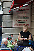 A waitress takes a lunch order at a cafe in central London.