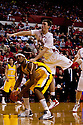 20 December 2011: Mike Fox #33 of the Nebraska Cornhuskers falls on Andre Coimbra #10 of the Central Michigan Chippewas during the first half at the Devaney Sports Center in Lincoln, Nebraska. Nebraska defeated Central Michigan 72 to 69.