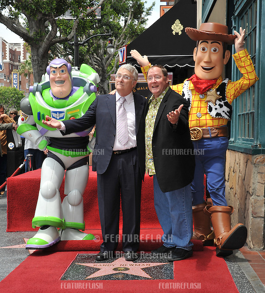 Composer Randy Newman (left) & Disney-Pixar boss  John Lasseter with Toy Story 3 stars Buzz Lightyear and Woody was honored today with a star on the Hollywood Walk of Fame..June 2, 2010  Los Angeles, CA.Picture: Paul Smith / Featureflash