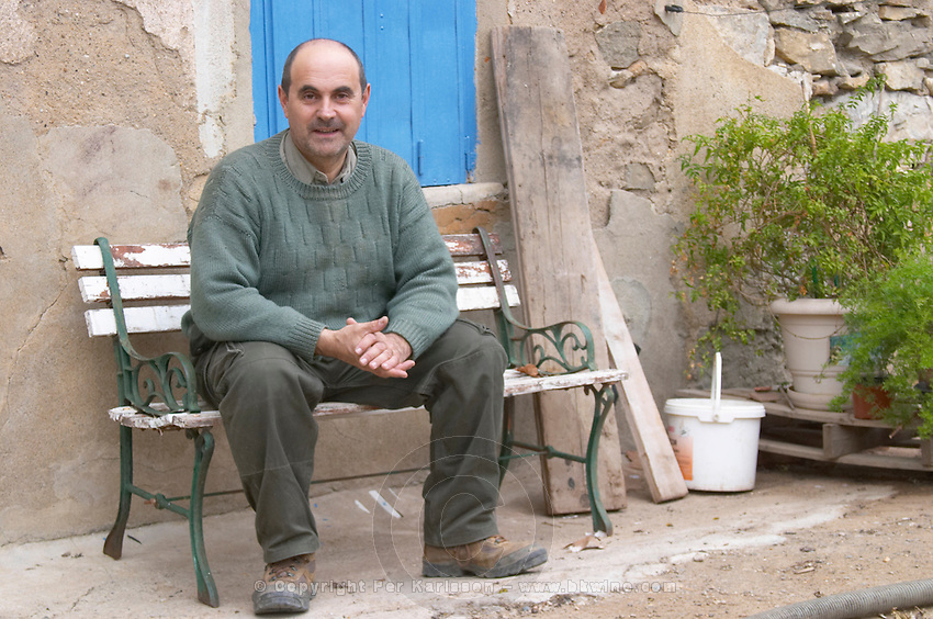 Domaine Entretan, J-C and D Plantade in Roubia. Minervois. Languedoc. Owner winemaker. Sitting on a bench outside the winery. France. Europe.