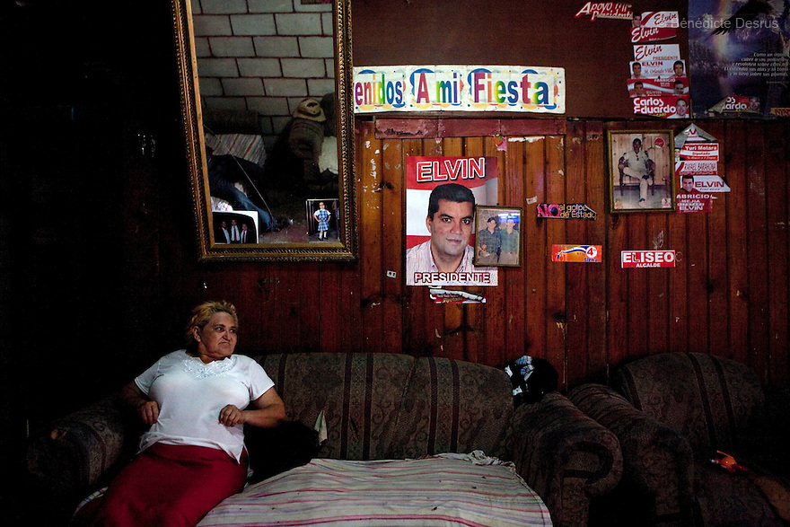 8 July 2009 - Tegucigalpa, Honduras  Bertha Lydia Rodriguez Paz, local coordinator for the Liberal Party of Honduras and supporter of ousted Honduran President Manuel Zelaya at her home in front of a poster of Elvin Ernesto Santos, the Liberal party candidate for the upcoming elections in November. Photo credit: Benedicte Desrus