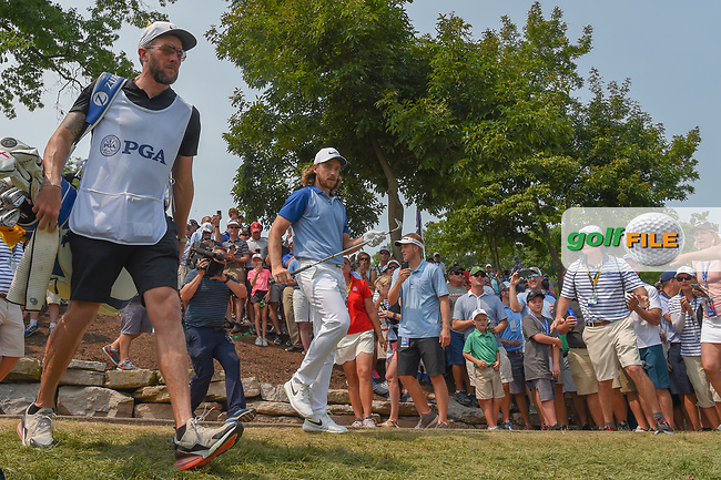 Tommy Fleetwood (ENG) heads to the green on 11 after a beautiful chip from the rocks during 4th round of the 100th PGA Championship at Bellerive Country Club, St. Louis, Missouri. 8/12/2018.<br /> Picture: Golffile | Ken Murray<br /> <br /> All photo usage must carry mandatory copyright credit (© Golffile | Ken Murray)