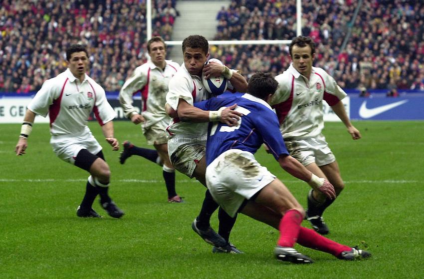 Photo.Richard Lane.France v England at Stade de France. 2-3-2002. Lloyds TSB Six Nations Championship..Jason Robinson is taskled by Tony Marsh close to the line.