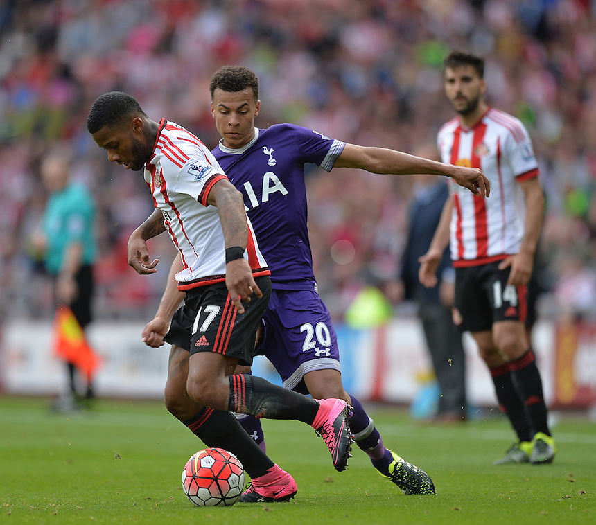 Sunderland's Jeremain Lens is tackled by Tottenham Hotspur's Dele Alli<br /> <br /> Photographer Dave Howarth/CameraSport<br /> <br /> Football - Barclays Premiership - Sunderland v Tottenham Hotspur - Sunday 13th September 2015 - Stadium of Light - Sunderland<br /> <br /> &copy; CameraSport - 43 Linden Ave. Countesthorpe. Leicester. England. LE8 5PG - Tel: +44 (0) 116 277 4147 - admin@camerasport.com - www.camerasport.com
