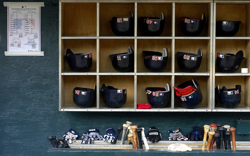 A still life of baseball equipment is neatly arranged in the Boston Red Sox dugout moments before a game against the Detroit Tigers during the 2006 MLB season.