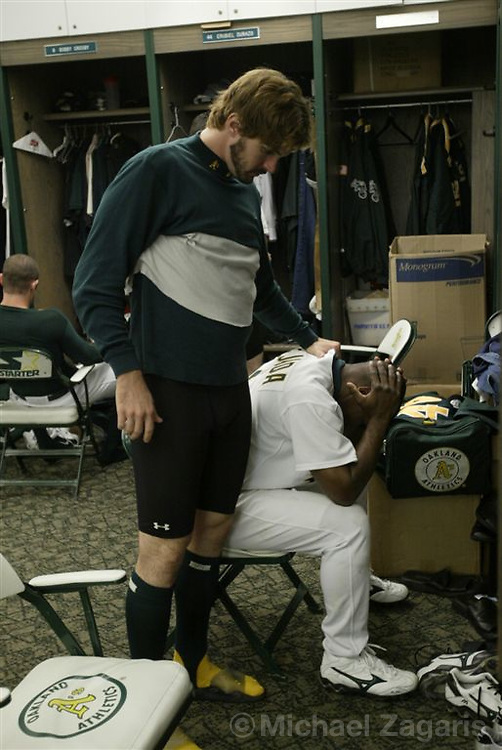 OAKLAND, CA - OCT 5: Barry Zito consoles Miguel Tejada in the clubhouse after the game  at the Network Assoc. Coliseum on Oct 5, 2003 in Oakland, Calif. The Red Sox defeated Oakland 3-1. ..(Photo by Michael Zagaris/MLB Photos)