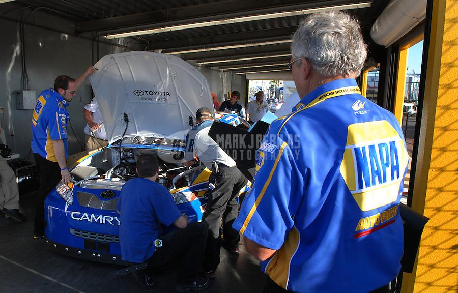 Feb 14, 2007; Daytona, FL, USA; A crew member looks on as the car of Nascar Nextel Cup driver Michael Waltrip (55) goes through tech inspection during practice for the Daytona 500 at Daytona International Speedway. Mandatory Credit: Mark J. Rebilas
