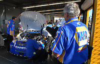 Feb 14, 2007; Daytona, FL, USA; A crew member looks on as the car of Nascar Nextel Cup driver Michael Waltrip (55) goes through tech inspection during practice for the Daytona 500 at Daytona International Speedway. Mandatory Credit: Mark J. Rebilas