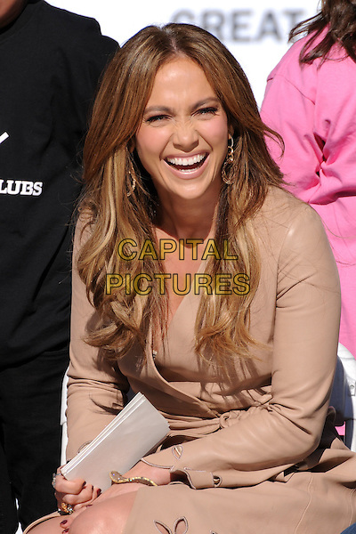 JENNIFER LOPEZ.Denzel Washington Announces Jennifer Lopez as the First Female Spokesperson for the Boys & Girls Club of America held at Nokia Plaza L.A. LIVE, Los Angeles, California, USA, .30th November 2010..half length brown camel coat beige sitting down smiling wrap cut out dress .CAP/ADM/BP.©Byron Purvis/AdMedia/Capital Pictures.