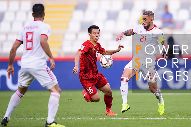 Pham Duc Huy of Vietnam (L) competes for the ball with Seyed Ashkan Dejagah of Iran (R) during the AFC Asian Cup UAE 2019 Group D match between Vietnam (VIE) and I.R. Iran (IRN) at Al Nahyan Stadium on 12 January 2019 in Abu Dhabi, United Arab Emirates. Photo by Marcio Rodrigo Machado / Power Sport Images