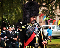 Drum major at 150th Ballater Highland Games in 2014. Massed pipe bands parade past Ballater Church
