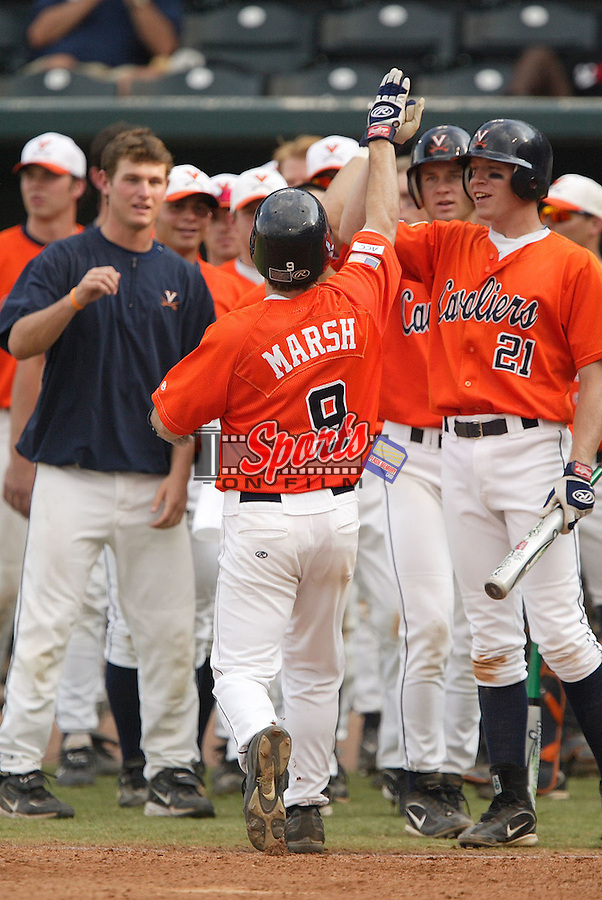 Virginia's Brandon Marsh (9) is congratulated by teammates following his home run versus North Carolina State at the 2006 ACC Baseball Championship at the Baseball Grounds of Jacksonville in Jacksonville, FL, Thursday, May 25, 2006.