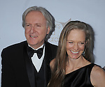 CENTURY CITY, CA. - February 20: James Cameron and wife Suzie Amis arrives at the 2010 Writers Guild Awards at the Hyatt Regency Century Plaza Hotel on February 20, 2010 in Los Angeles, California.