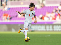 ORLANDO, FL - MARCH 05: Saki Kumagai #4 of Japan dribbles during a game between Spain and Japan at Exploria Stadium on March 05, 2020 in Orlando, Florida.