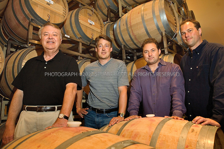 7/24/2007--Snohomish, WA, United States..From left to right:  Alex Golitzin,  John Ware, Paul Golitzin and Marv Crum posing inside the Quilceda Creek Winery, 45 minutes drive north of Seattle, with glasses of their 2004 cabernet sauvignon. One of the earliest producers of cabernet sauvignon there and now one of the best in the country. It's a family operation, run mostly by Alex Golitzin and his son, Paul. Also involved are John Ware and Marv Crum (they are both related to the Golitzin's)...Photograph ©2007 Stuart Isett.All rights reserved