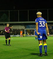 AFC Wimbledon's Lyle Taylor disagrees with referee, Michael Jones during the Sky Bet League 1 match between AFC Wimbledon and MK Dons at the Cherry Red Records Stadium, Kingston, England on 22 September 2017. Photo by Carlton Myrie / PRiME Media Images.