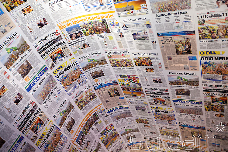 A collage of articles from Brazilian and international newspapers all reporting Rio de Janeiro winning the bid to host the 2016 Olympic games, as part of the Casa Brazil Exhibition, Somerset House, London 2012.