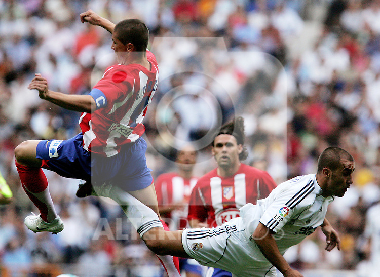 Atletico de Madrid's Fernando Torres during a challenge with Real Madrid's Fabio Cannavaro during Spanish La Liga match between Real Madrid and Atletico de Madrid at Santiago Bernabeu stadium in Madrid, Sunday 01 October, 2006. (ALTERPHOTOS/Alvaro Hernandez).