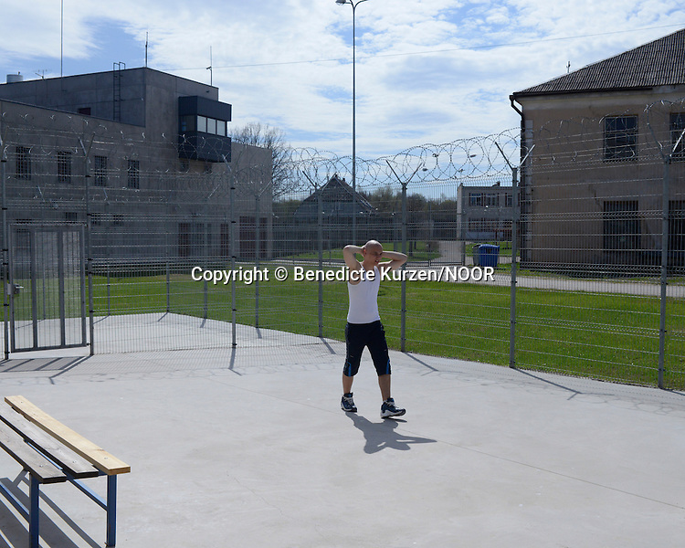 One of the inmate walks in the courtyard at the Cesu correctional institution of juveniles which has been renovated in one part and newly built in other part, Cesu, May 2013. <br /> <br /> There are 50 inmates at the moment at the correctional institution. During the day inmates are allowed to go in and out of their cells.