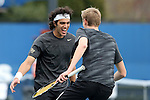 22 March 2015: Wake Forest Skander Mansouri (TUN) (left) and Christian Seraphim (DEU) (right) celebrate winning their doubles match. The Duke University Blue Devils hosted the Wake Forest University Demon Deacons at Ambler Stadium in Durham, North Carolina in a 2014-15 NCAA Division I Men's Tennis match. Duke won the match 4-3.