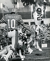 Oakland Invader punter Stan Talley has his punt blocked by Denver Gold #25 Darryl Hemphill and Tom Kilkenny.(1985 photo/Ron Riesterer)