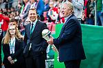 01.05.2019, RheinEnergie Stadion , Köln, GER, 1.FBL, Borussia Dortmund vs FC Schalke 04, DFB REGULATIONS PROHIBIT ANY USE OF PHOTOGRAPHS AS IMAGE SEQUENCES AND/OR QUASI-VIDEO<br /> <br /> im Bild | picture shows:<br /> der ehemalige DFB Frauen Trainer Horst Hrubesch trägt den DFB Pokal auf das Feld, <br /> <br /> Foto © nordphoto / Rauch