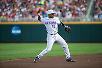 Richie Martin (12) of the Florida Gators throws during a game between the Miami Hurricanes and Florida Gators at TD Ameritrade Park on June 13, 2015 in Omaha, Nebraska. (Brace Hemmelgarn/Four Seam Images)