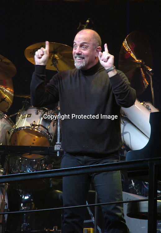 "Billy Joel singing..at the Celebration of the beginning of the Third Year of ""Movin' Out"" on Broadway on October 24, 2004 at the Richard Rogers Theatre. Photo by Robin Platzer, Twin Images"